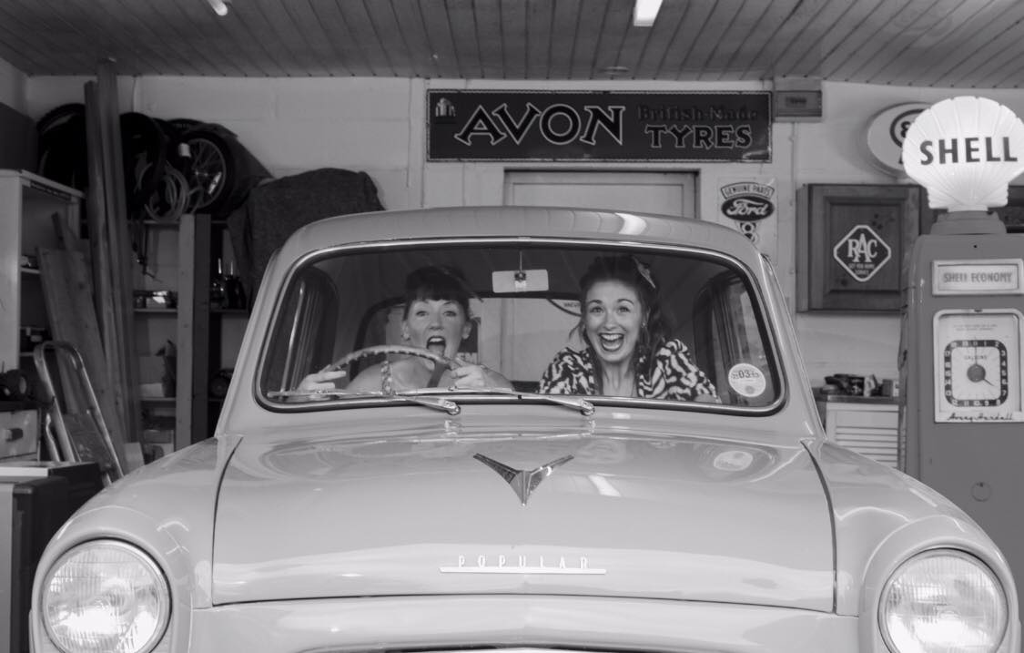 girls laughing driving ford popular